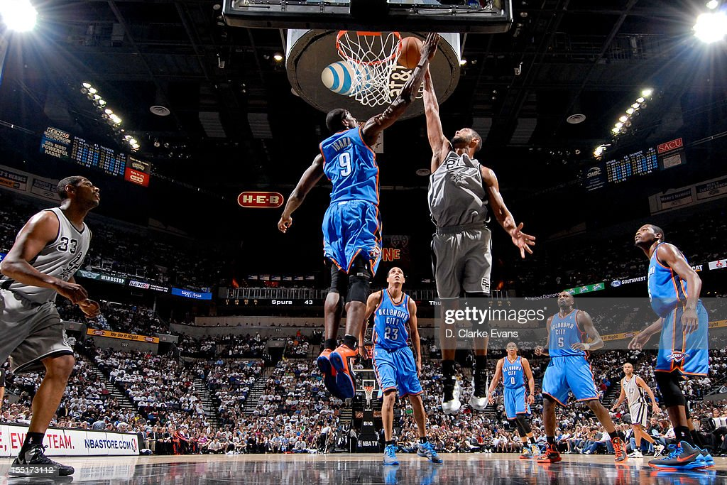 <a gi-track='captionPersonalityLinkClicked' href=/galleries/search?phrase=Tim+Duncan&family=editorial&specificpeople=201467 ng-click='$event.stopPropagation()'>Tim Duncan</a> #21 of the San Antonio Spurs dunks against <a gi-track='captionPersonalityLinkClicked' href=/galleries/search?phrase=Serge+Ibaka&family=editorial&specificpeople=5133378 ng-click='$event.stopPropagation()'>Serge Ibaka</a> #9 of the Oklahoma City Thunder on November 1, 2012 at the AT&T Center in San Antonio, Texas.