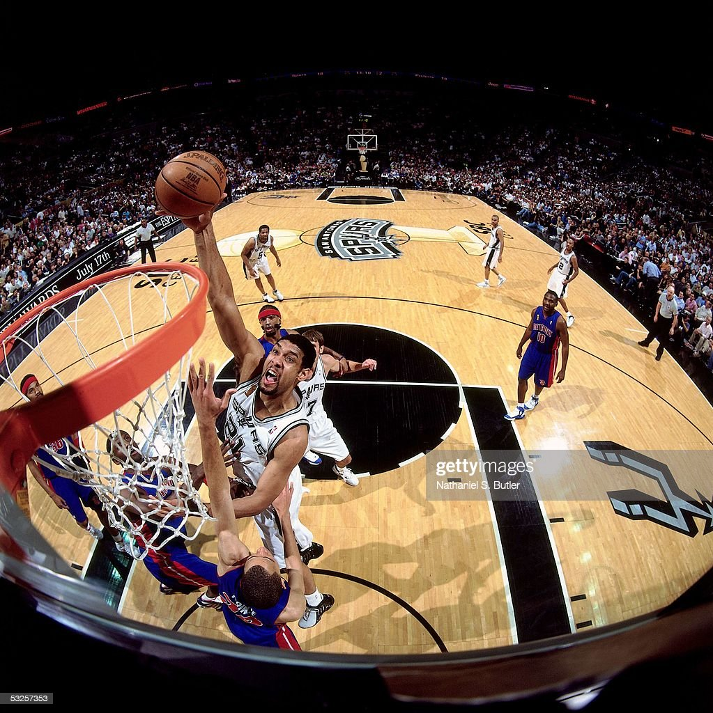 Tim Duncan #21 of the San Antonio Spurs dunks against Tayshaun Prince #22 of the Detroit Pistons in Game Seven of the 2005 NBA Finals June 23, 2005 at the SBC Center in San Antonio, Texas. The Spurs defeated the Pistons 81-74.