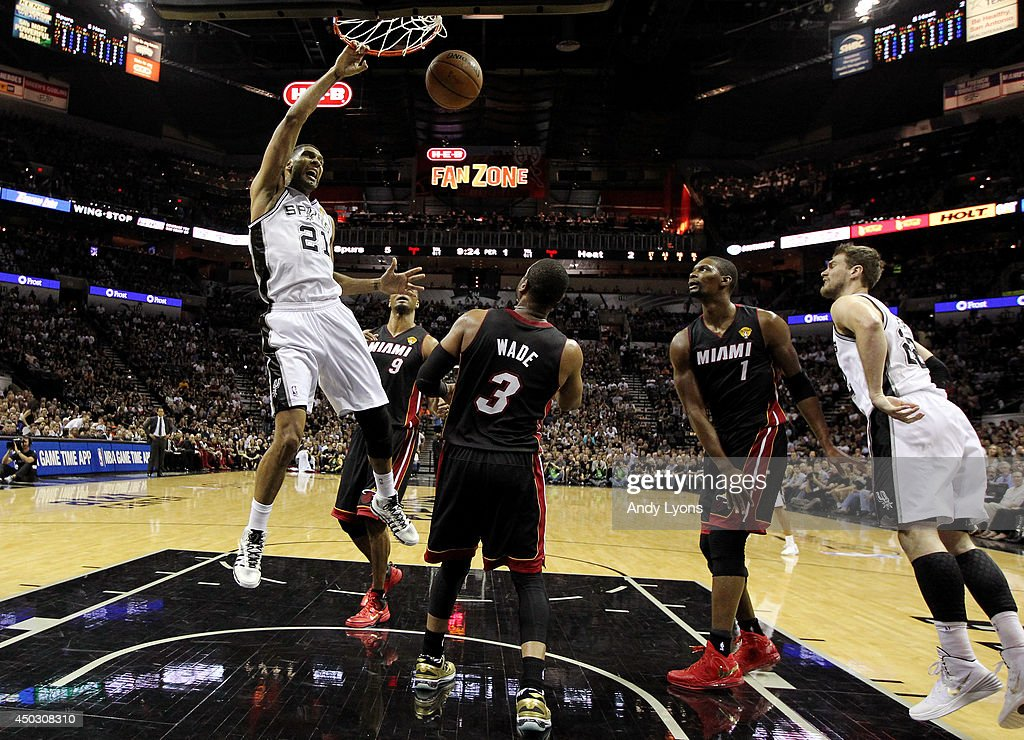 <a gi-track='captionPersonalityLinkClicked' href=/galleries/search?phrase=Tim+Duncan&family=editorial&specificpeople=201467 ng-click='$event.stopPropagation()'>Tim Duncan</a> #21 of the San Antonio Spurs dunks against the Miami Heat during Game Two of the 2014 NBA Finals at the AT&T Center on June 8, 2014 in San Antonio, Texas.