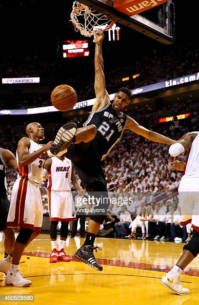 Tim Duncan of the San Antonio Spurs dunks against the Miami Heat during Game Four of the 2014 NBA Finals at American Airlines Arena on June 12 2014...