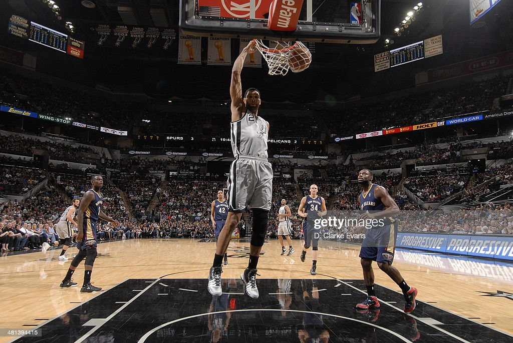 Tim Duncan #21 of the San Antonio Spurs dunks against the New Orleans Pelicans at the AT&T Center on March 29, 2014 in San Antonio, Texas.