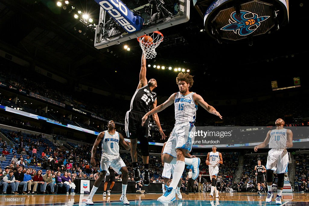 Tim Duncan #21 of the San Antonio Spurs dunks against the New Orleans Hornets on January 7, 2013 at the New Orleans Arena in New Orleans, Louisiana.