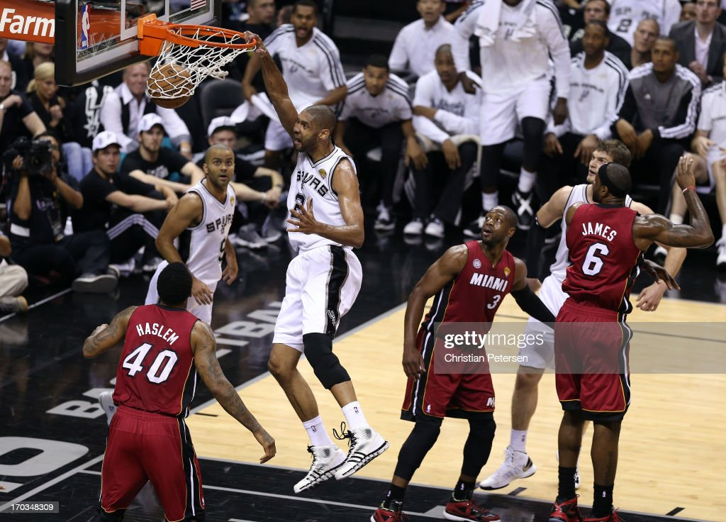<a gi-track='captionPersonalityLinkClicked' href=/galleries/search?phrase=Tim+Duncan&family=editorial&specificpeople=201467 ng-click='$event.stopPropagation()'>Tim Duncan</a> #21 of the San Antonio Spurs dunks the ball against <a gi-track='captionPersonalityLinkClicked' href=/galleries/search?phrase=Udonis+Haslem&family=editorial&specificpeople=201748 ng-click='$event.stopPropagation()'>Udonis Haslem</a> #40 of the Miami Heat in the first quarter during Game Three of the 2013 NBA Finals at the AT&T Center on June 11, 2013 in San Antonio, Texas.