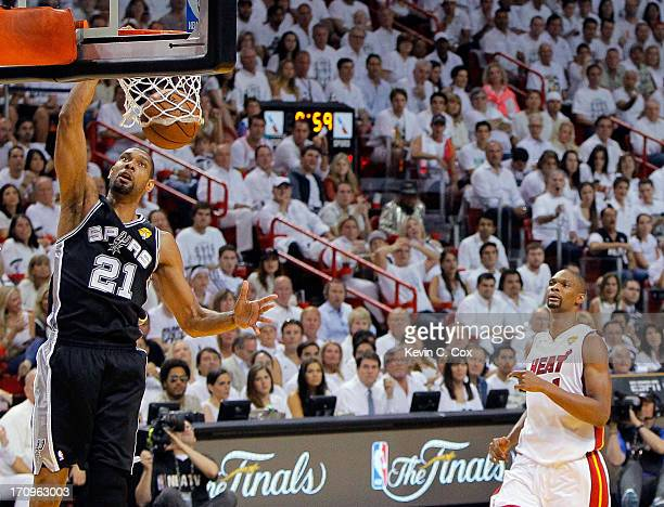 Tim Duncan of the San Antonio Spurs dunks the ball in front of Chris Bosh of the Miami Heat in the first half during Game Seven of the 2013 NBA...