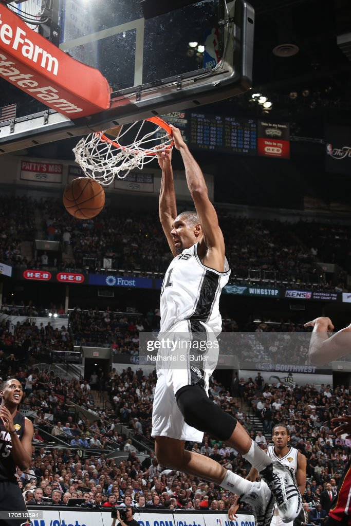 Tim Duncan #21 of the San Antonio Spurs dunks while playing against the Miami Heat in Game Four of the 2013 NBA Finals on June 13, 2013 at the AT&T Center in San Antonio, Texas.
