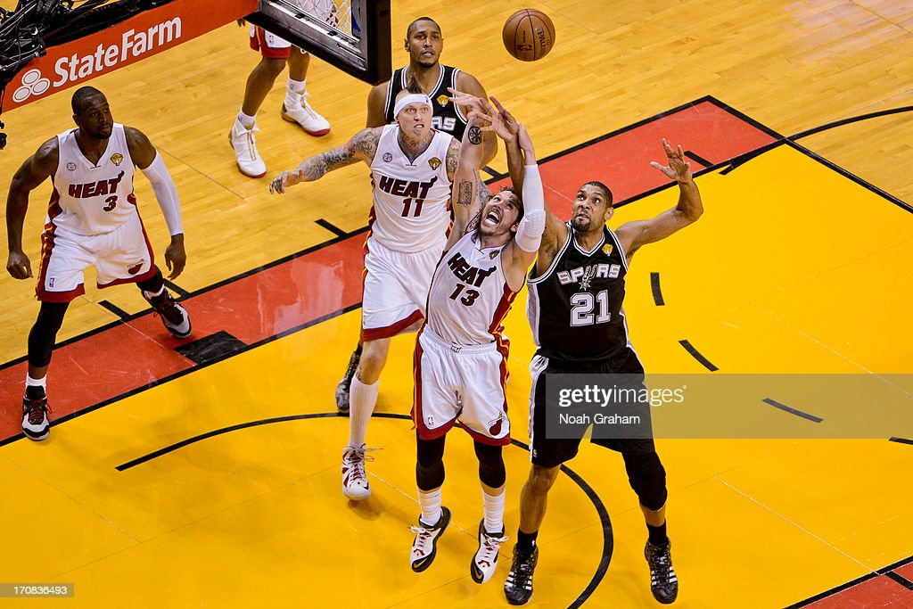Tim Duncan #21 of the San Antonio Spurs fights for a rebound against Mike Miller #13 of the Miami Heat during Game Six of the 2013 NBA Finals on June 18, 2013 at American Airlines Arena in Miami, Florida.