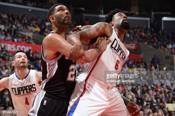 Tim Duncan of the San Antonio Spurs fights for position against DeAndre Jordan of the Los Angeles Clippers on February 18 2016 at STAPLES Center in...