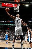 Tim Duncan of the San Antonio Spurs gets the rebound during the game against the Dallas Mavericks on November 25 2015 at the ATT Center in San...