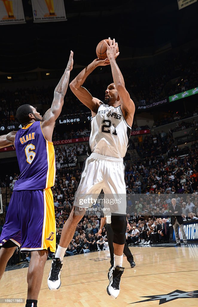 Tim Duncan #21 of the San Antonio Spurs goes for a jump shot against Earl Clark #6 of the Los Angeles Lakers during the game between the Los Angeles Lakers and the San Antonio Spurs on January 9, 2013 at the AT&T Center in San Antonio, Texas.