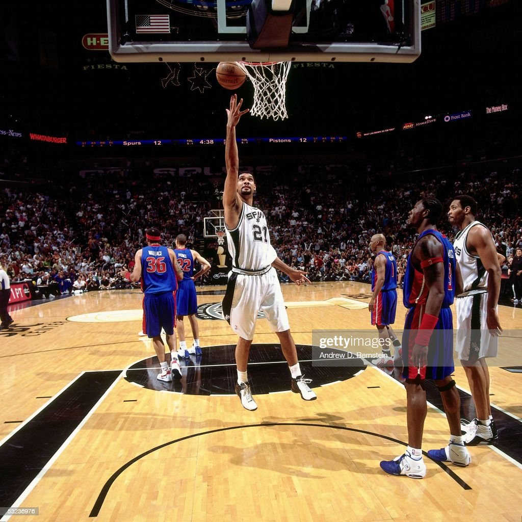Tim Duncan #21 of the San Antonio Spurs goes for a layup against Ben Wallace #3 of the Detroit Pistons in Game Seven of the 2005 NBA Finals on June 23, 2005 at the SBC Center in San Antonio, Texas. The Spurs defeated the Pistons 81-74.