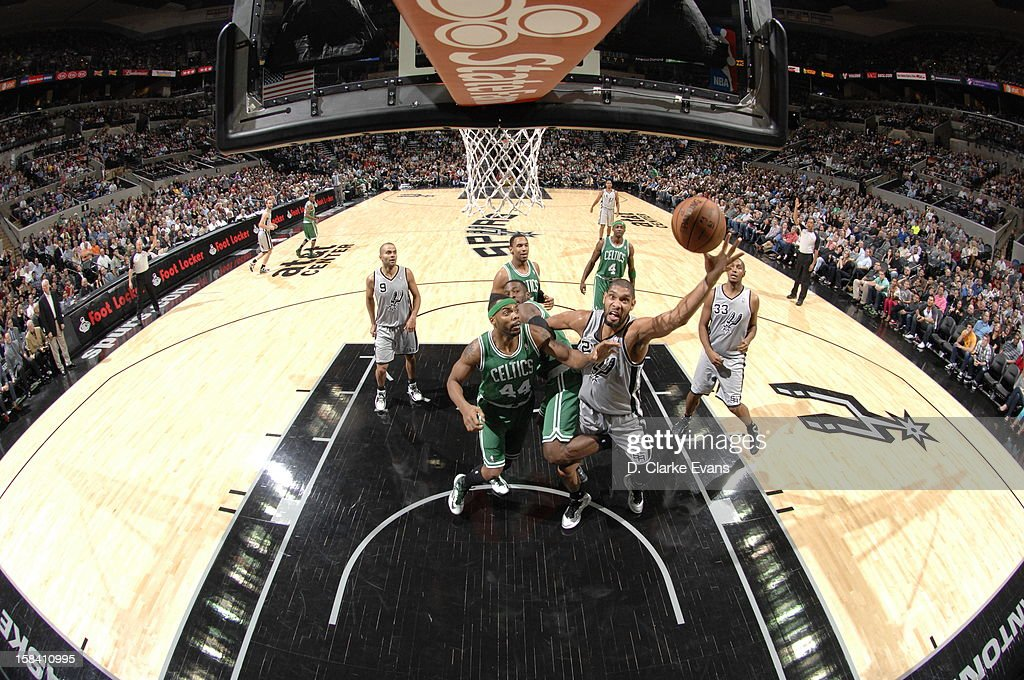 <a gi-track='captionPersonalityLinkClicked' href=/galleries/search?phrase=Tim+Duncan&family=editorial&specificpeople=201467 ng-click='$event.stopPropagation()'>Tim Duncan</a> #21 of the San Antonio Spurs goes to the basket against <a gi-track='captionPersonalityLinkClicked' href=/galleries/search?phrase=Chris+Wilcox&family=editorial&specificpeople=202038 ng-click='$event.stopPropagation()'>Chris Wilcox</a> #44 of the Boston Celtics during the game between the Boston Celtics and the San Antonio Spurs on December 15, 2012 at the AT&T Center in San Antonio, Texas.