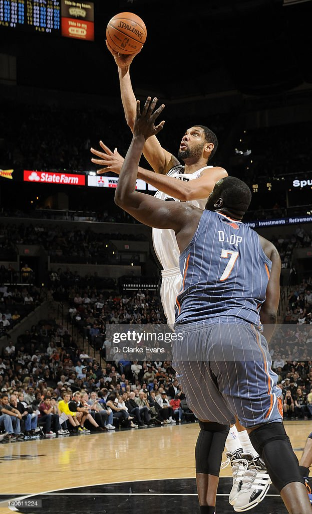 Tim Duncan #21 of the San Antonio Spurs goes to the basket against DeSagana Diop #7 of the Charlotte Bobcats during the game at the AT&T Center on March 2, 2012 in San Antonio, Texas.