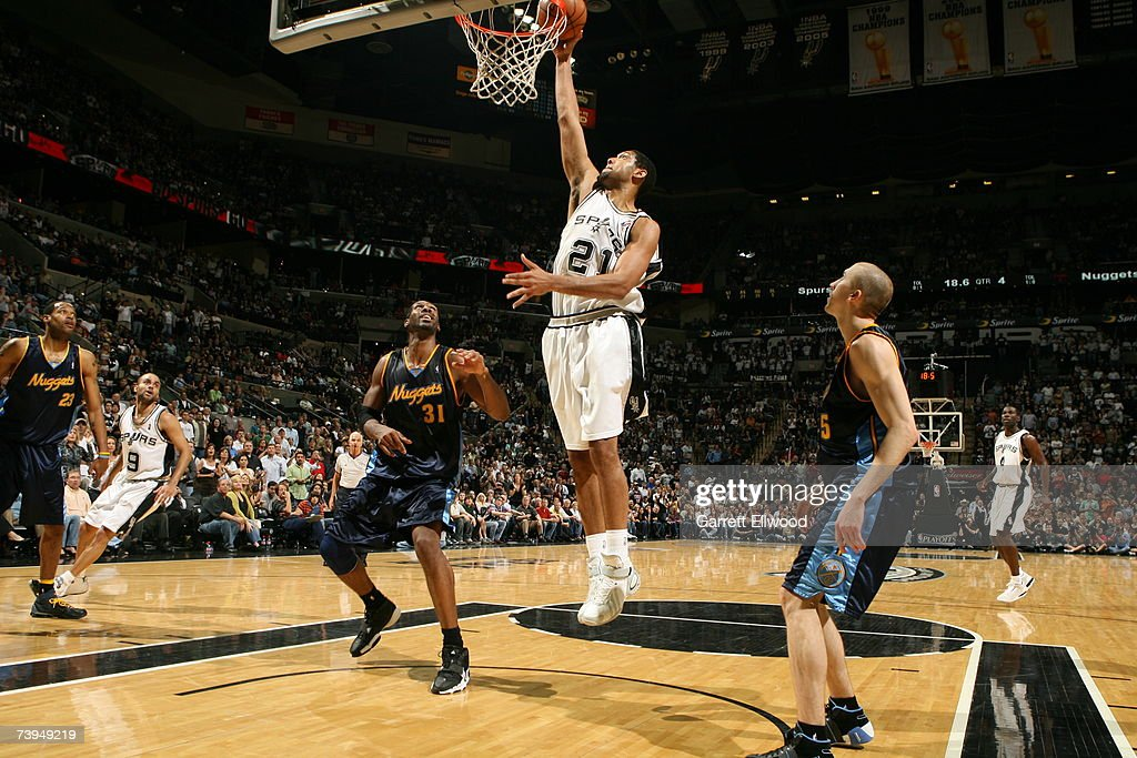 Tim Duncan #21 of the San Antonio Spurs goes to the basket against Nene #31 of the Denver Nuggets in Game One of the Western Conference Quarterfinals during the 2007 NBA Playoffs at AT&T Center on April 22, 2007 in San Antonio, Texas.