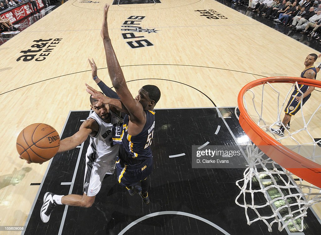 <a gi-track='captionPersonalityLinkClicked' href=/galleries/search?phrase=Tim+Duncan&family=editorial&specificpeople=201467 ng-click='$event.stopPropagation()'>Tim Duncan</a> #21 of the San Antonio Spurs goes to the basket against <a gi-track='captionPersonalityLinkClicked' href=/galleries/search?phrase=Roy+Hibbert&family=editorial&specificpeople=725128 ng-click='$event.stopPropagation()'>Roy Hibbert</a> #55 of the Indiana Pacers during the game between the Indiana Pacers and the San Antonio Spurs on November 5, 2012 at the AT&T Center in San Antonio, Texas.