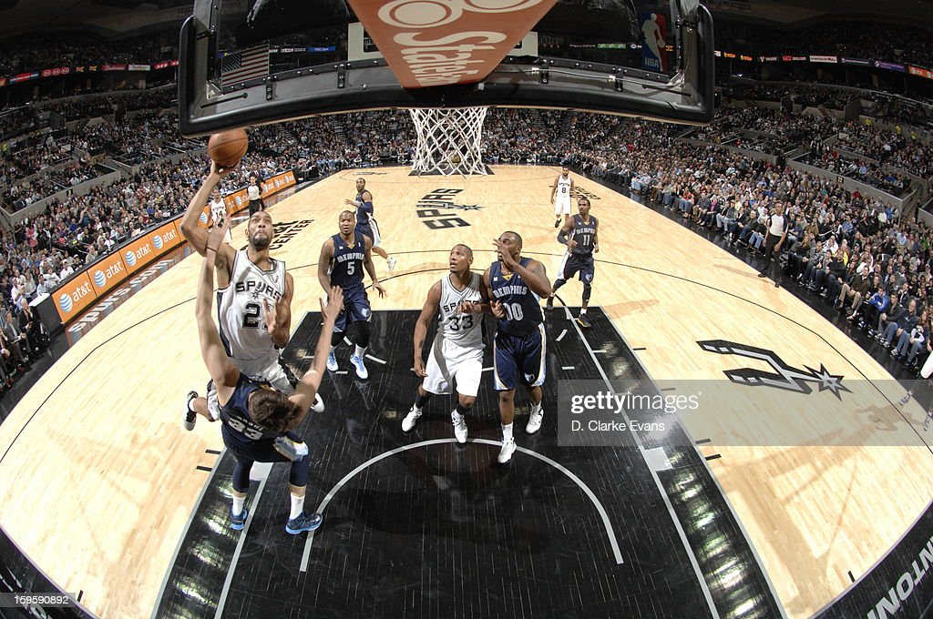 <a gi-track='captionPersonalityLinkClicked' href=/galleries/search?phrase=Tim+Duncan&family=editorial&specificpeople=201467 ng-click='$event.stopPropagation()'>Tim Duncan</a> #21 of the San Antonio Spurs goes to the basket against the Memphis Grizzlies on January 16, 2013 at the AT&T Center in San Antonio, Texas.