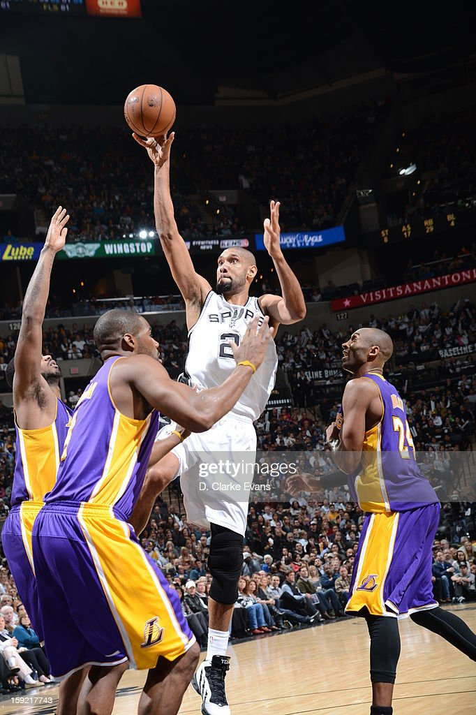 Tim Duncan #21 of the San Antonio Spurs goes to the basket against triple defense during the game between the Los Angeles Lakers and the San Antonio Spurs on January 9, 2013 at the AT&T Center in San Antonio, Texas.