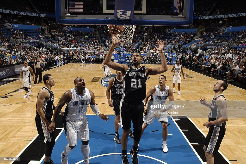 <a gi-track='captionPersonalityLinkClicked' href=/galleries/search?phrase=Tim+Duncan&family=editorial&specificpeople=201467 ng-click='$event.stopPropagation()'>Tim Duncan</a> #21 of the San Antonio Spurs goes to the basket during the game between the San Antonio Spurs and the Orlando Magic on November 28, 2012 at Amway Center in Orlando, Florida.