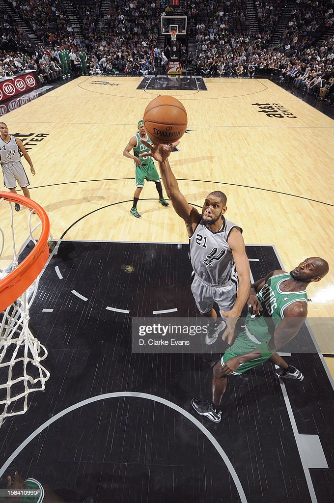 <a gi-track='captionPersonalityLinkClicked' href=/galleries/search?phrase=Tim+Duncan&family=editorial&specificpeople=201467 ng-click='$event.stopPropagation()'>Tim Duncan</a> #21 of the San Antonio Spurs goes to the basket during the game between the Boston Celtics and the San Antonio Spurs on December 15, 2012 at the AT&T Center in San Antonio, Texas.