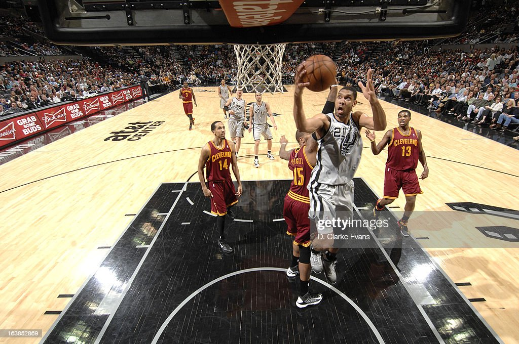 Tim Duncan #21 of the San Antonio Spurs goes to the basket during the game between the Cleveland Cavaliers and the San Antonio Spurs on March 16, 2013 at the AT&T Center in San Antonio, Texas.