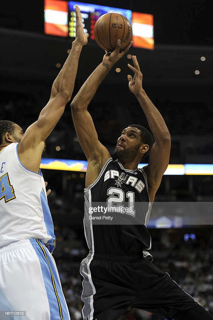 Tim Duncan #21 of the San Antonio Spurs goes up for a jump shot against Randy Foye #4 of the Denver Nuggets in the second quarter of an NBA game at the Pepsi Center on November 5, 2013, in Denver, Colorado.