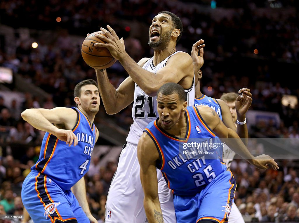 Tim Duncan #21 of the San Antonio Spurs goes up for a shot against Thabo Sefolosha #25 of the Oklahoma City Thunder in the first quarter in Game Two of the Western Conference Finals during the 2014 NBA Playoffs at AT&T Center on May 21, 2014 in San Antonio, Texas.