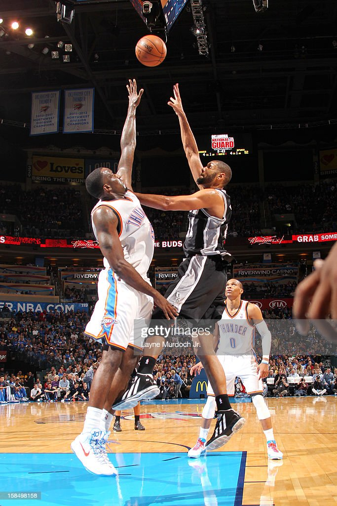 <a gi-track='captionPersonalityLinkClicked' href=/galleries/search?phrase=Tim+Duncan&family=editorial&specificpeople=201467 ng-click='$event.stopPropagation()'>Tim Duncan</a> #21 of the San Antonio Spurs goes up for the close shot against <a gi-track='captionPersonalityLinkClicked' href=/galleries/search?phrase=Kendrick+Perkins&family=editorial&specificpeople=211461 ng-click='$event.stopPropagation()'>Kendrick Perkins</a> #5 of the Oklahoma City Thunder during an NBA game on December 17, 2012 at the Chesapeake Energy Arena in Oklahoma City, Oklahoma.