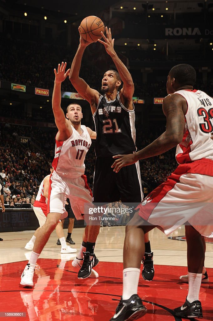 Tim Duncan #21 of the San Antonio Spurs goes up for the easy bucket vs the Toronto Raptors during the game on November 25, 2012 at the Air Canada Centre in Toronto, Ontario, Canada.