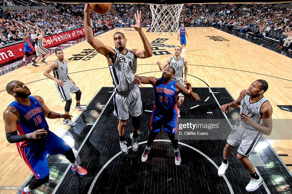 <a gi-track='captionPersonalityLinkClicked' href=/galleries/search?phrase=Tim+Duncan&family=editorial&specificpeople=201467 ng-click='$event.stopPropagation()'>Tim Duncan</a> #21 of the San Antonio Spurs grabs a rebound against Jason Maxiell #54 of the Detroit Pistons on March 3, 2013 at the AT&T Center in San Antonio, Texas.
