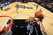 Tim Duncan of the San Antonio Spurs grabs a rebound against the Minnesota Timberwolves at the ATT Center on December 6 2014 in San Antonio Texas NOTE...