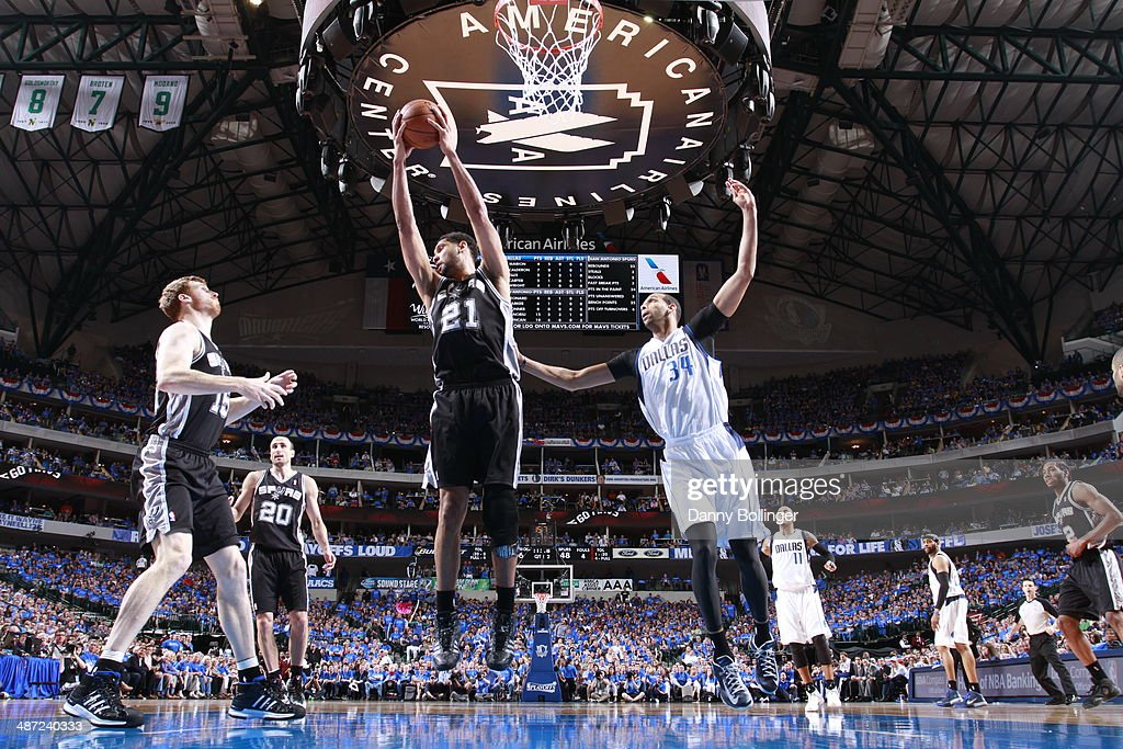 Tim Duncan #21 of the San Antonio Spurs grabs a rebound against the Dallas Mavericks in Game Four of the Western Conference Quarterfinals during the 2014 NBA Playoffs on April 28, 2014 at the American Airlines Center in Dallas, Texas.