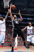 Tim Duncan of the San Antonio Spurs grabs a rebound against the Los Angeles Clippers in Game Seven of the Western Conference Quarterfinals during the...