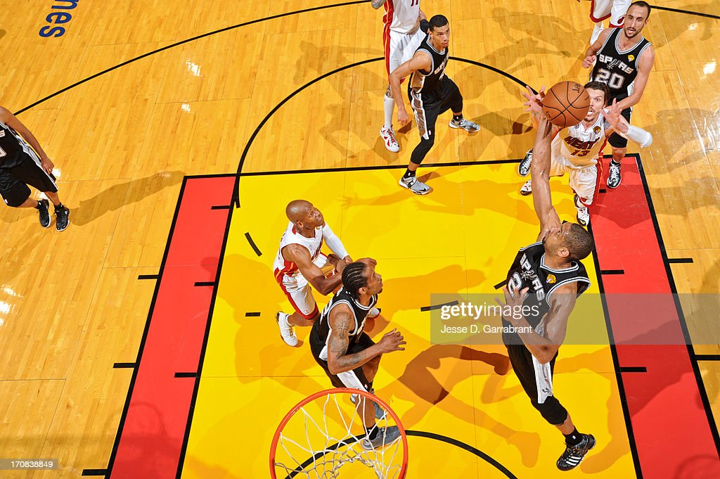 Tim Duncan #21 of the San Antonio Spurs grabs a rebound against the Miami Heat during Game Six of the 2013 NBA Finals on June 18, 2013 at American Airlines Arena in Miami, Florida.