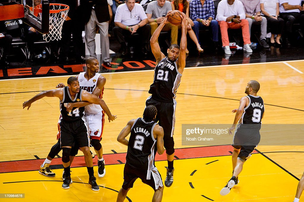 Tim Duncan #21 of the San Antonio Spurs grabs a rebound against the Miami Heat during Game Seven of the 2013 NBA Finals on June 20, 2013 at American Airlines Arena in Miami, Florida.