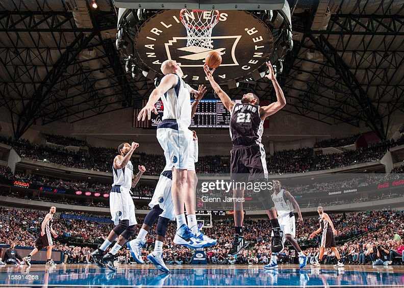 <a gi-track='captionPersonalityLinkClicked' href=/galleries/search?phrase=Tim+Duncan&family=editorial&specificpeople=201467 ng-click='$event.stopPropagation()'>Tim Duncan</a> #21 of the San Antonio Spurs grabs a rebound against the Dallas Mavericks on December 30, 2012 at the American Airlines Center in Dallas, Texas.