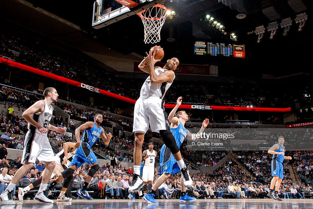 Tim Duncan #21 of the San Antonio Spurs grabs a rebound against the Orlando Magic on April 3, 2013 at the AT&T Center in San Antonio, Texas.