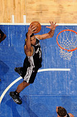Tim Duncan of the San Antonio Spurs grabs a rebound against the Orlando Magic on April 1 2015 at Amway Center in Orlando Florida NOTE TO USER User...