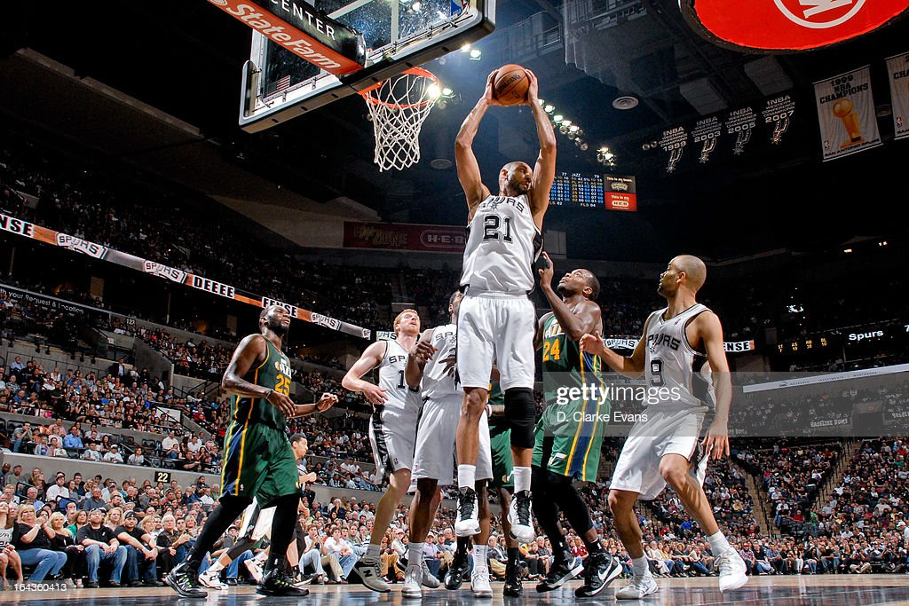Tim Duncan #21 of the San Antonio Spurs grabs a rebound against the Utah Jazz on March 22, 2013 at the AT&T Center in San Antonio, Texas. Duncan's 16 rebounds in the game secured 13th place for him on the NBA all-time career rebounding list.