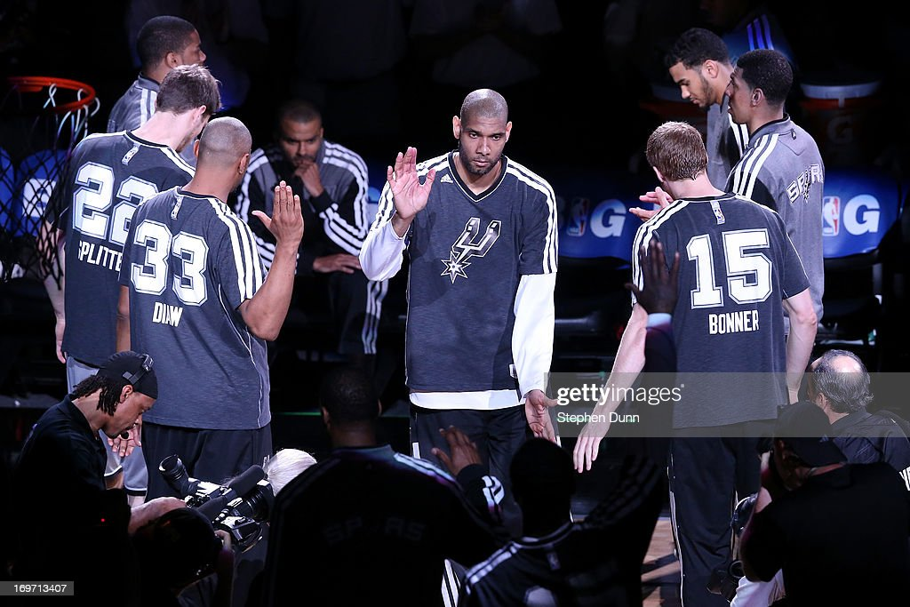<a gi-track='captionPersonalityLinkClicked' href=/galleries/search?phrase=Tim+Duncan&family=editorial&specificpeople=201467 ng-click='$event.stopPropagation()'>Tim Duncan</a> #21 of the San Antonio Spurs greets his teammates during player introductions against the Memphis Grizzlies during Game One of the Western Conference Finals of the 2013 NBA Playoffs at AT&T Center on May 19, 2013 in San Antonio, Texas.
