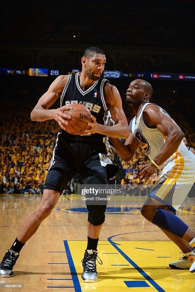 <a gi-track='captionPersonalityLinkClicked' href=/galleries/search?phrase=Tim+Duncan&family=editorial&specificpeople=201467 ng-click='$event.stopPropagation()'>Tim Duncan</a> #21 of the San Antonio Spurs handles the ball against <a gi-track='captionPersonalityLinkClicked' href=/galleries/search?phrase=Carl+Landry&family=editorial&specificpeople=4111952 ng-click='$event.stopPropagation()'>Carl Landry</a> #7 of the Golden State Warriors in Game Three of the Western Conference Semifinals during the 2013 NBA Playoffs on May 10, 2013 at the Oracle Arena in Oakland, California.