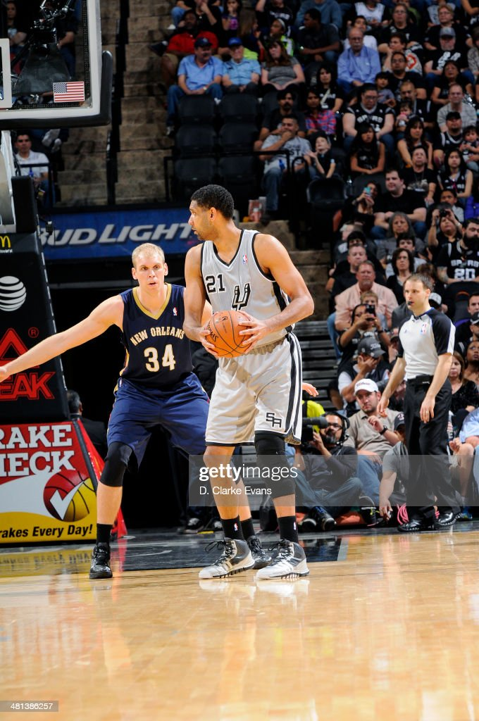 Tim Duncan #21 of the San Antonio Spurs handles the ball against Greg Stiemsma #34 of the New Orleans Pelicans at the AT&T Center on March 29, 2014 in San Antonio, Texas.