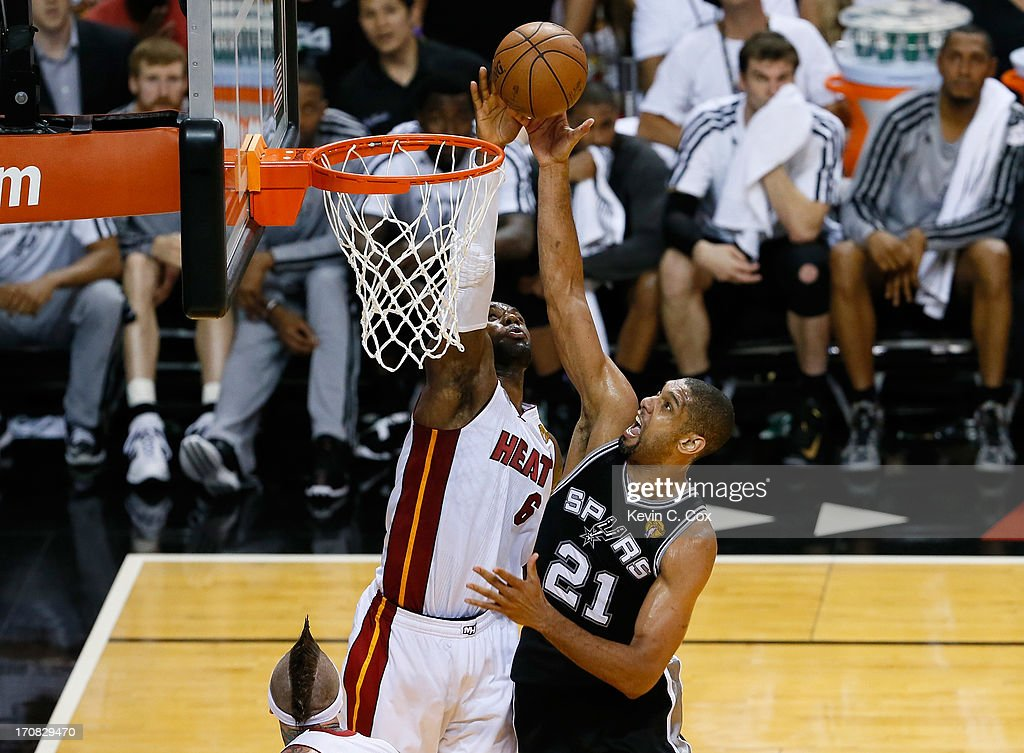 Tim Duncan #21 of the San Antonio Spurs has his shot blocked by LeBron James #6 of the Miami Heat in the fourth quarter during Game Six of the 2013 NBA Finals at AmericanAirlines Arena on June 18, 2013 in Miami, Florida.