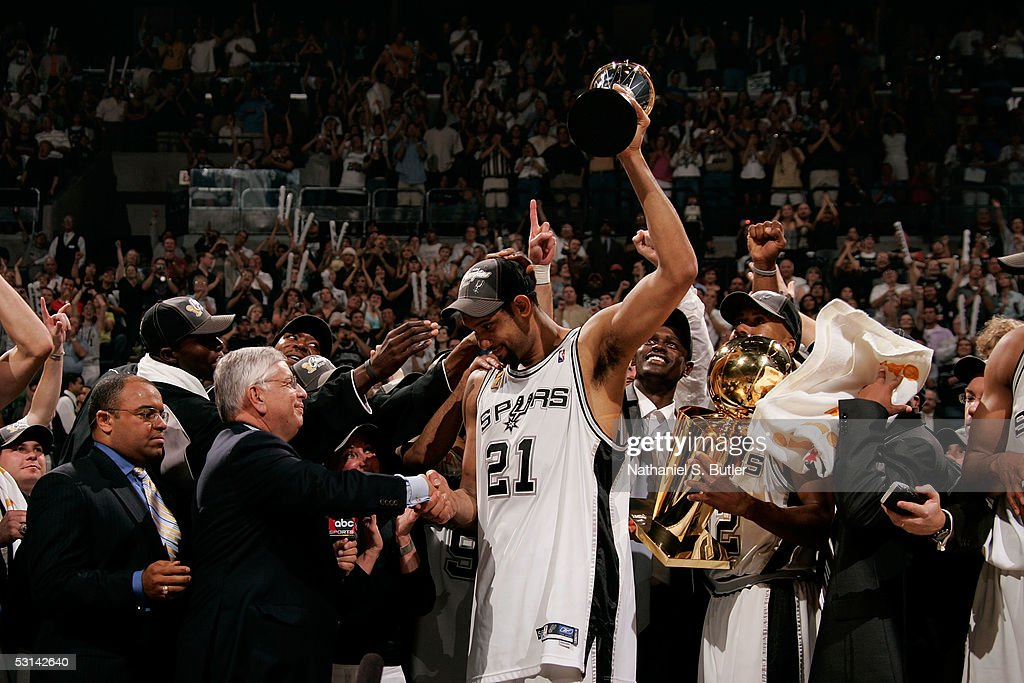 Tim Duncan #21 of the San Antonio Spurs holds up the Finals MVP trophy as he shakes hands with NBA Commissioner David Stern following the Spurs 81-74 win against the Detroit Pistons in Game Seven of the 2005 NBA Finals to win the Championship on June 23, 2005 at SBC Center in San Antonio.