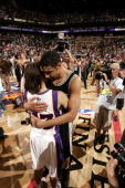 Tim Duncan of the San Antonio Spurs hugs Steve Nash of the Phoenix Suns after the Spurs victory in Game five of the Western Conference Finals during...