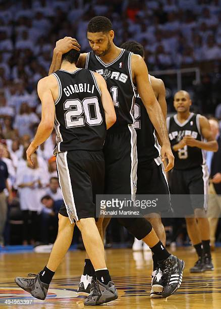 Tim Duncan of the San Antonio Spurs hugs teammate Manu Ginobili after Ginobili hit a threepoint shot against the Oklahoma City Thunder in the second...