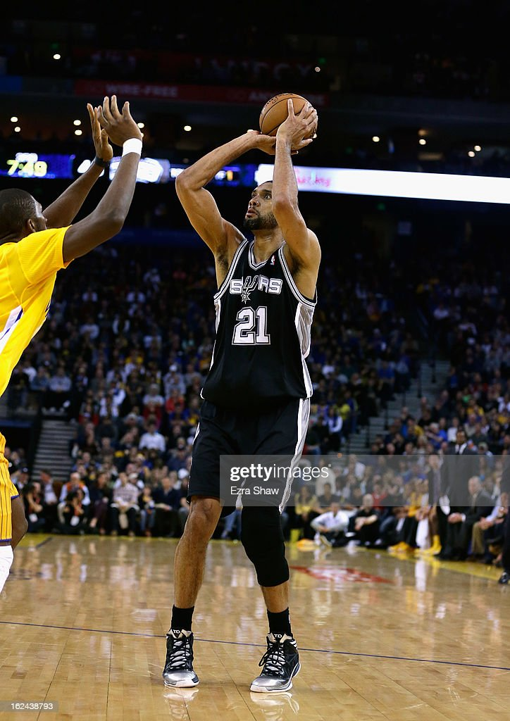Tim Duncan #21 of the San Antonio Spurs in action against the Golden State Warriors at Oracle Arena on February 22, 2013 in Oakland, California. The Warriors are wearing new short-sleeved uniforms for the first time. The Warriors won the game in overtime.