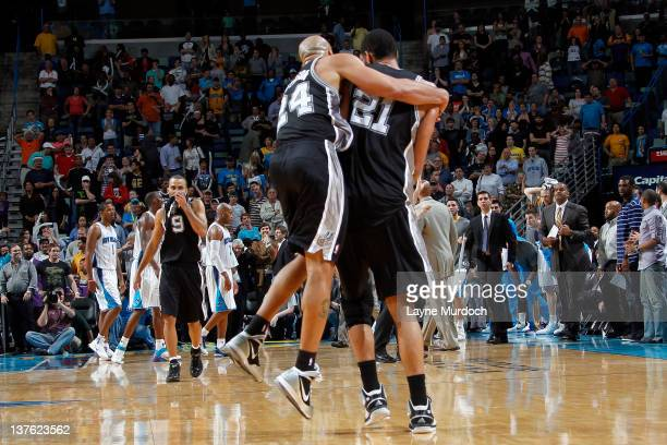 Tim Duncan of the San Antonio Spurs is congratulated by Richard Jefferson after scoring the game winning shot against the New Orleans Hornets on...
