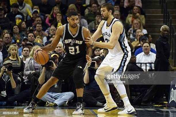 Tim Duncan of the San Antonio Spurs is defended by Marc Gasol of the Memphis Grizzlies during a game at the FedExForum on December 30 2014 in Memphis...