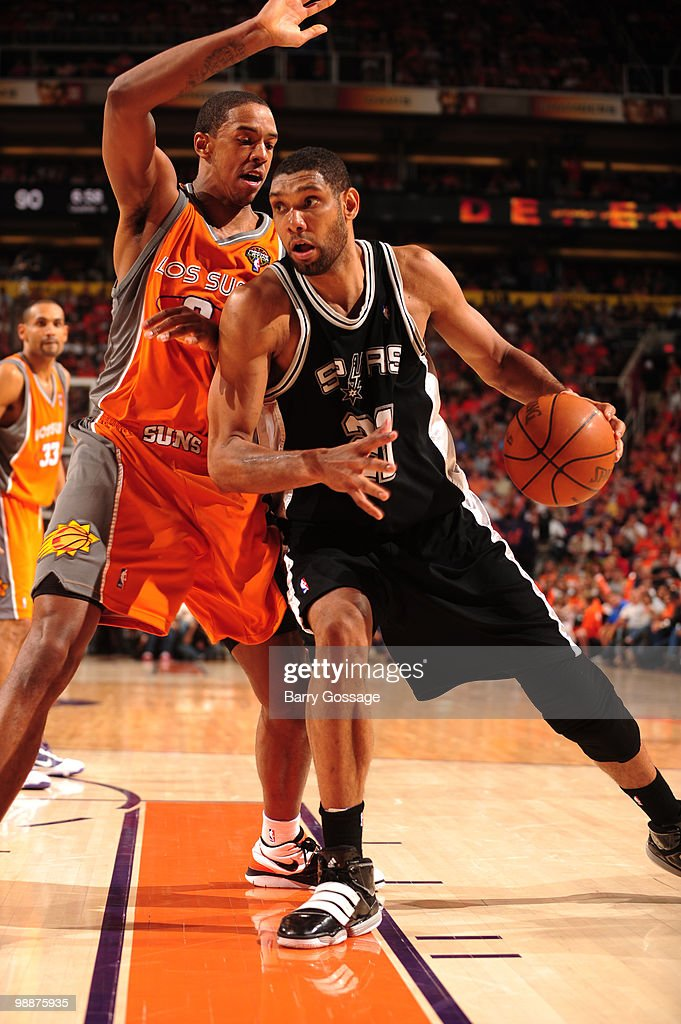 Tim Duncan #21 of the San Antonio Spurs is guarded by Channing Frye #8 of the Phoenix Suns in Game Two of the Western Conference Semifinals during the 2010 NBA Playoffs on May 5, 2010 at U.S. Airways Center in Phoenix, Arizona. The Suns are wearing their 'Los Suns' jerseys on Cinco de Mayo in response to an illegal-immigration law signed into law by the governor.