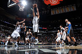 Tim Duncan of the San Antonio Spurs jumps for the rebound against the Orlando Magic during the game against the on February 4 2015 at ATT Center in...