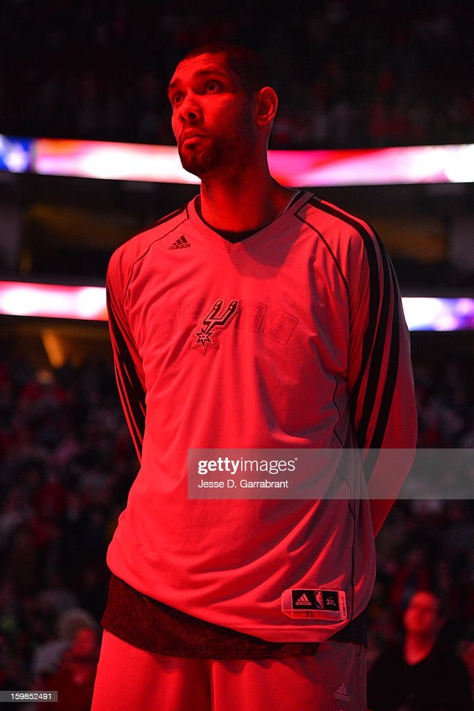 Tim Duncan #21 of the San Antonio Spurs looks on during the National Anthem before the game against the Philadelphia 76ers at the Wells Fargo Center on January 21, 2013 in Philadelphia, Pennsylvania.